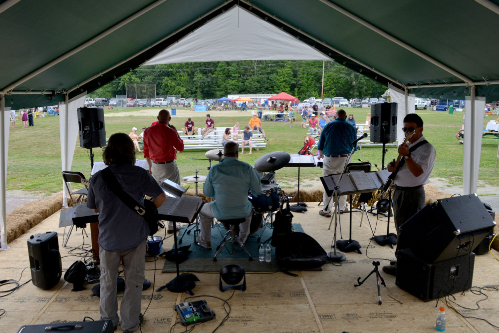 The Scott Davis Band performs during OakFest behind Williams Elementary School in Oakland on Saturday.