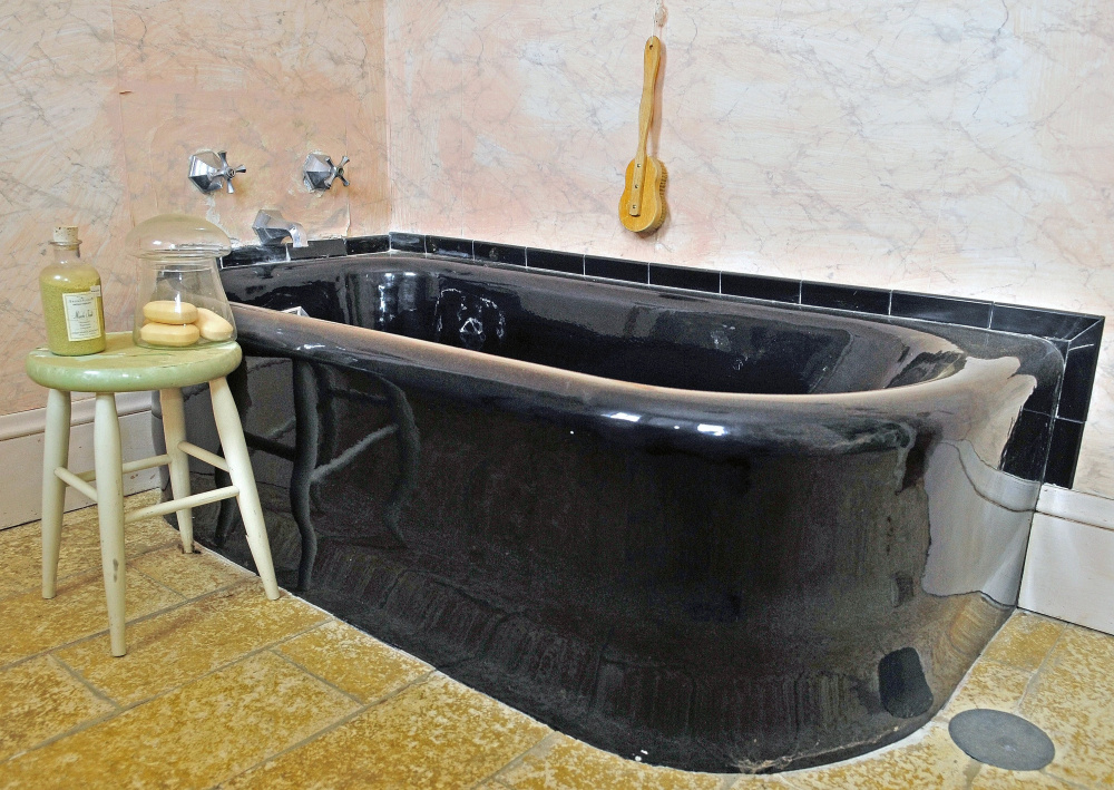This photo taken on June 11, 2014, shows the master bathroom which features a curved tub at Maine Chance Farm in Mount Vernon. The estate formerly owned by Elizabeth Arden was sold to the Travis Mills Foundation. Craig Buck said that the tub and other items were salvaged before renovations started.