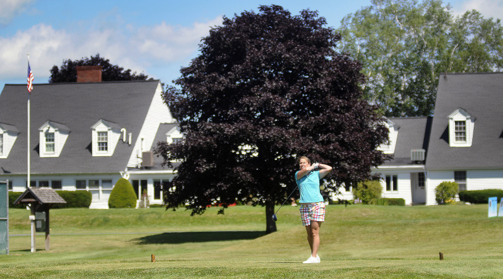 Elissa Emmons tees off at the Augusta Country Club in Manchester on July 11.