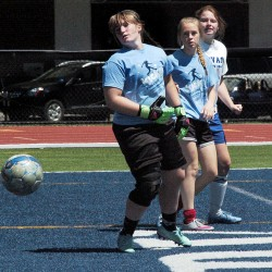 A Mt. Blue shot gets past Waterville goalie Gabi Martin during a marathon soccer game to benefit the ShineOnCass Foundation on Sunday at Colby College.