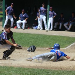Augusta 13's baserunner Akira Warren slides in safely to score a run during a New England regional pool play game against Pittsfield, Massachusetts, in Rochester, New Hampshire on Monday morning. Augusta fell, 6-1.