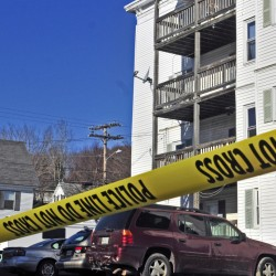 Police tape surrounds the parking lot at 75 Washington St. in November 2015 in Augusta following a homicide.