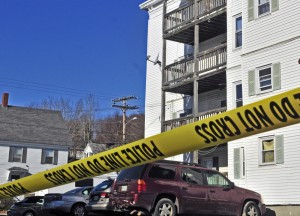 Police tape surrounds the parking lot at 75 Washington St. in November 2015 in Augusta after Joseph Marceau, 31, of Augusta, was found dead in an apartment in the building at right.