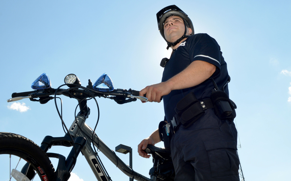 Officer Kyle McDonald, seen Tuesday, is one of the Waterville Police Department's bike patrol officer.
