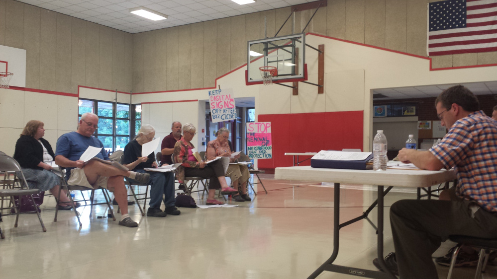 Residents state their concerns about proposed changes to China's land development code Tuesday night during a public hearing held by the Planning Board at China Middle School.