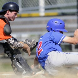 Skowhegan catcher Will Stinson tags out Yankee Ford's Alex Livingston during the American Legion state tournament Wednesday in Augusta.
