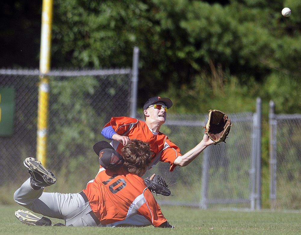 Skowhegan's Evan Bess, right, gets ready to catch a pop up after colliding with teammate Adam Turcotte in right field against Yankee Ford during the American Legion state tournament Wednesday in Augusta.