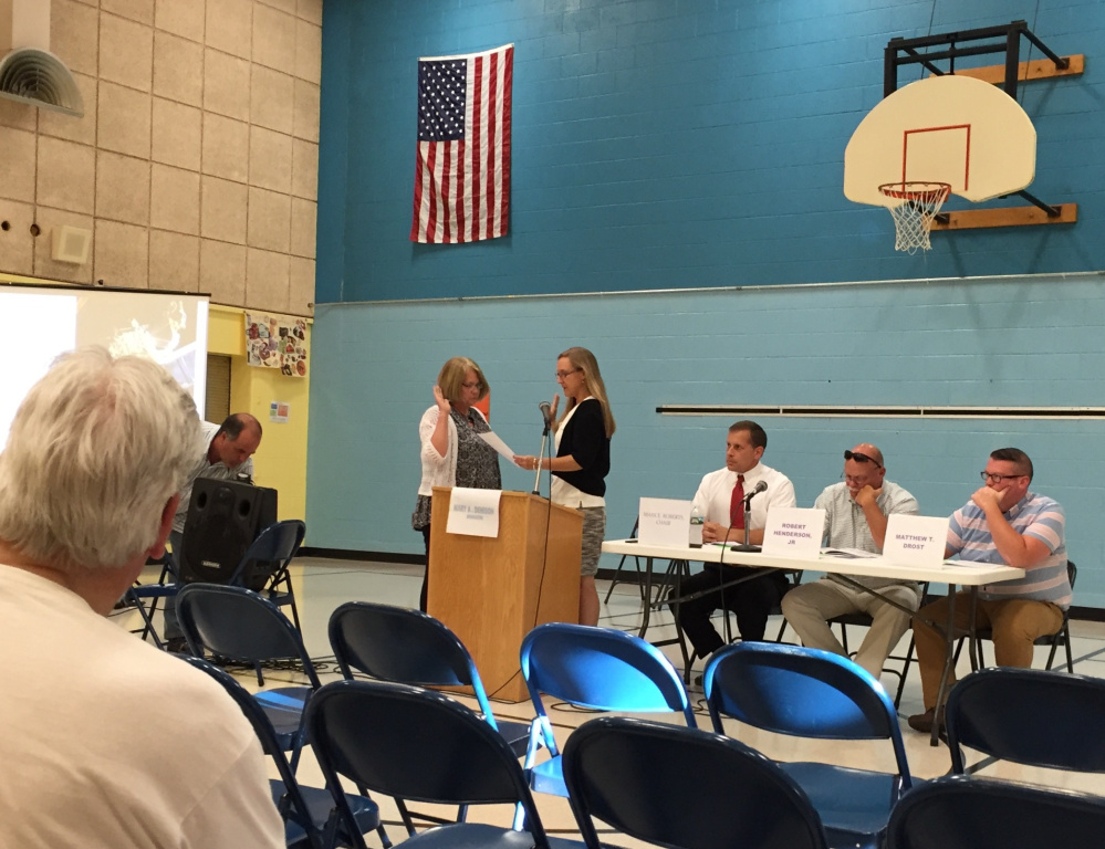 Randolph Town Clerk Lynn Mealey swears in moderator Mary Denison at the start of Wednesday's Town Meeting.