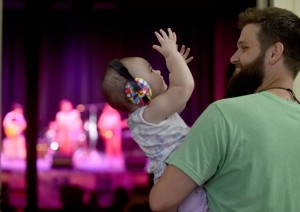 Chris Cote dances with 14-month-old Elana Brown, as Yard Sail plays on the stage at the Waterville Opera House on Thursday as part of the free concert series Waterville Rocks! The show was moved from the planned outside venue of Castonguay Square to inside the Waterville Opera House as storms blew through the region. Shows are also scheduled on Aug. 11, Aug. 25 and Sept. 22.