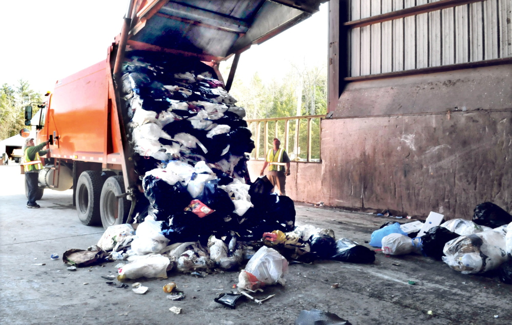 Waterville Public Works employees deliver a load of refuse at the Oakland transfer station. Waterville City Manager Mike Roy, a member of the Municipal Review Committee board, asked the board unsuccessfully this week not to go through with a scheduled tipping free hike, because of the city's suspended budget.