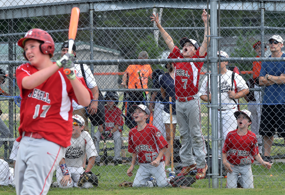 Peperrell, Massachusetts Cal Ripken players celebrate in the background as teammate Connor Rocco Lamonica hits a home run during the Cal Ripken U12 home run derby at Carl Wright Complex in Skowhegan on Friday.