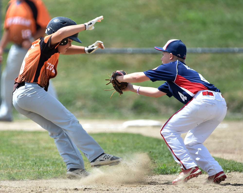 Skowhegan's Hunter McEwen (6) gets caught in a pickle by Freetown/Lakeville's Curt Heath during the 11-year-old Cal Ripken New England tournament Saturday at Carl Wright Complex in Skowhegan.