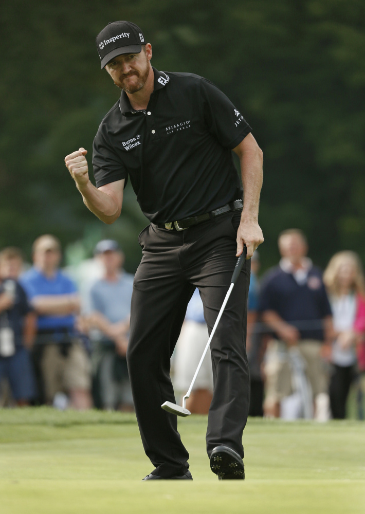 Jimmy Walker reacts to his birdie putt on the 11th hole during the final round of the PGA Championship on Sunday at Baltusrol Golf Club in Springfield, New Jersey. Walker earned a one-shot victory over Jason Day.