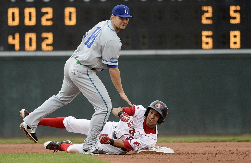 Portland's Mauricio Dubon tries to break up a double play on Benjamin Michael of the Hartford Yard Goats in Friday's first game. Shawn Patrick Ouellette/Staff Photographer