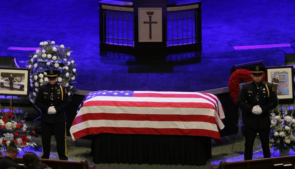 An honor guard stands watch over the casket of Dallas Police Sr. Cpl. Lorne Ahrens during his funeral service at Prestonwood Baptist Church in Plano, Texas, on Wednesday.