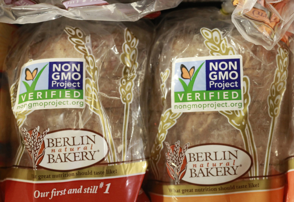 Products labeled as containing no Genetically Modified Organisms, or GMOs, are sold at a store. A new bill would give the U.S. Agriculture Department two years to write new labeling rules.