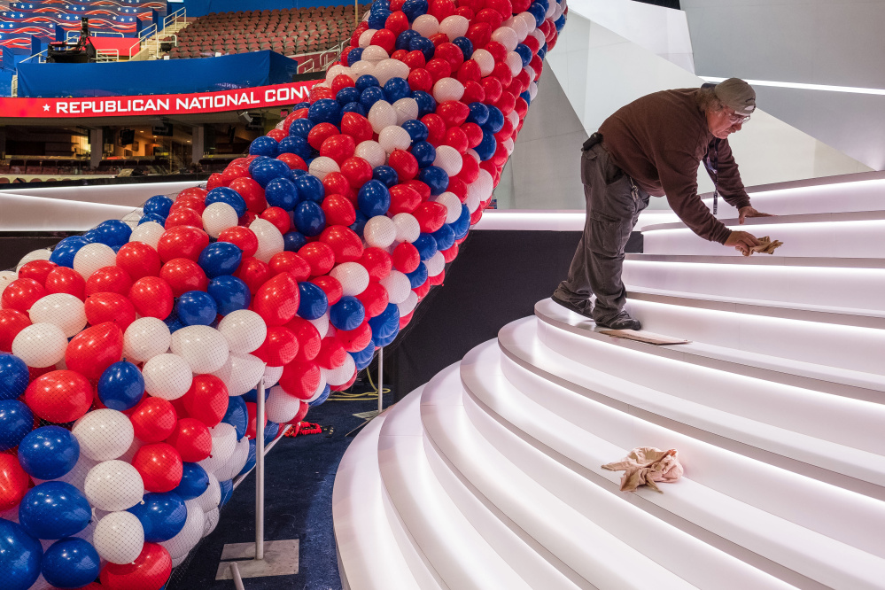 A member of a construction crew polishes the front of the stage for the opening of the Republican National Convention in Cleveland. With protesters planning to make noise and the Republican Party still divided over the nomination of Donald Trump, some Maine delegates say the convention could be contentious.