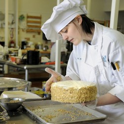 Culinary arts student Chauncel Berry adds nuts to a carrot cake she made for a four-course meal in 2010 that was open to the public.