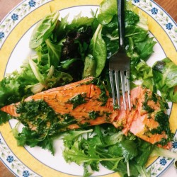 Fillet of salmon in an herb marinade and served over a green salad is the kind of light meal that appeals during summer.