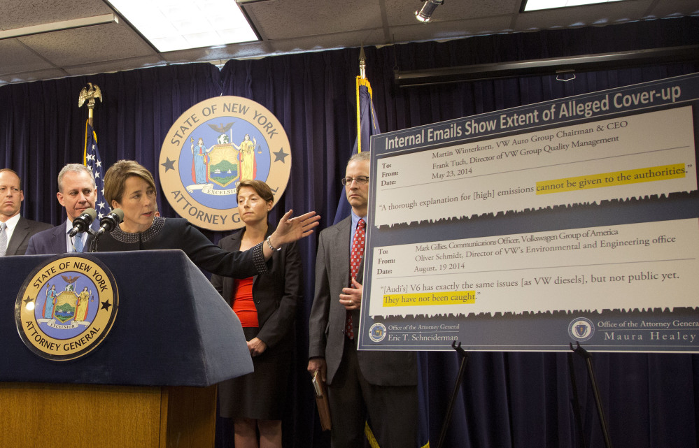 Massachusetts Attorney General Maura Healey, with New York Attorney General Eric Schneiderman (second from left), discusses a lawsuit against Volkswagen on Tuesday in New York.