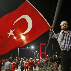 A pro-government supporter waves a Turkish flag Thursday during a demonstration on the road leading to Istanbul's iconic Bosporus Bridge.