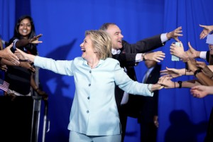 Democratic presidential candidate Hillary Clinton and Sen. Tim Kaine, D-Va., arrive together at a rally at Florida International University Panther Arena in Miami on Saturday. Clinton has chosen Kaine to be her running mate.
