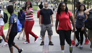 Colin Allen, creator of 'White Men for Black Lives,' stands on the Freedom Trail amid a group of summer-camp children in Boston, Mass. Some white Americans say they're being spurred to action after the shootings of black men by police officers.