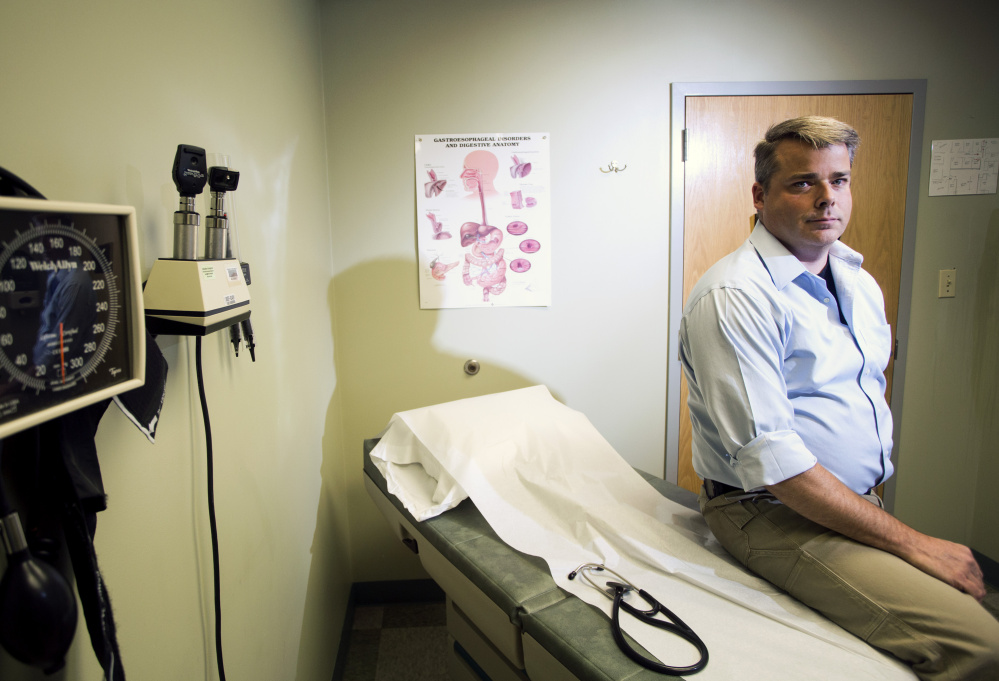 """Dr. Craig Smith of Bridgton says treating addicts with Suboxone has """"turned out to be the most gratifying part of the job."""" (Derek Davis/Staff Photographer)"""