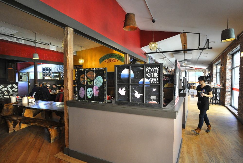 Buck's Naked BBQ, shown in 2013, is closing its Wharf Street, Portland, location. The space is being taken over by a sports bar.