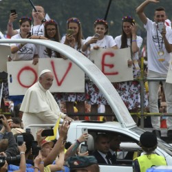 Faithful participating in the World Youth Days wave to Pope Francis on his popemobile in Krakow's Jordan Park in Poland on Thursday. The Pope is on a five-day visit to Poland which will culminate with the World Youth Day on Sunday.