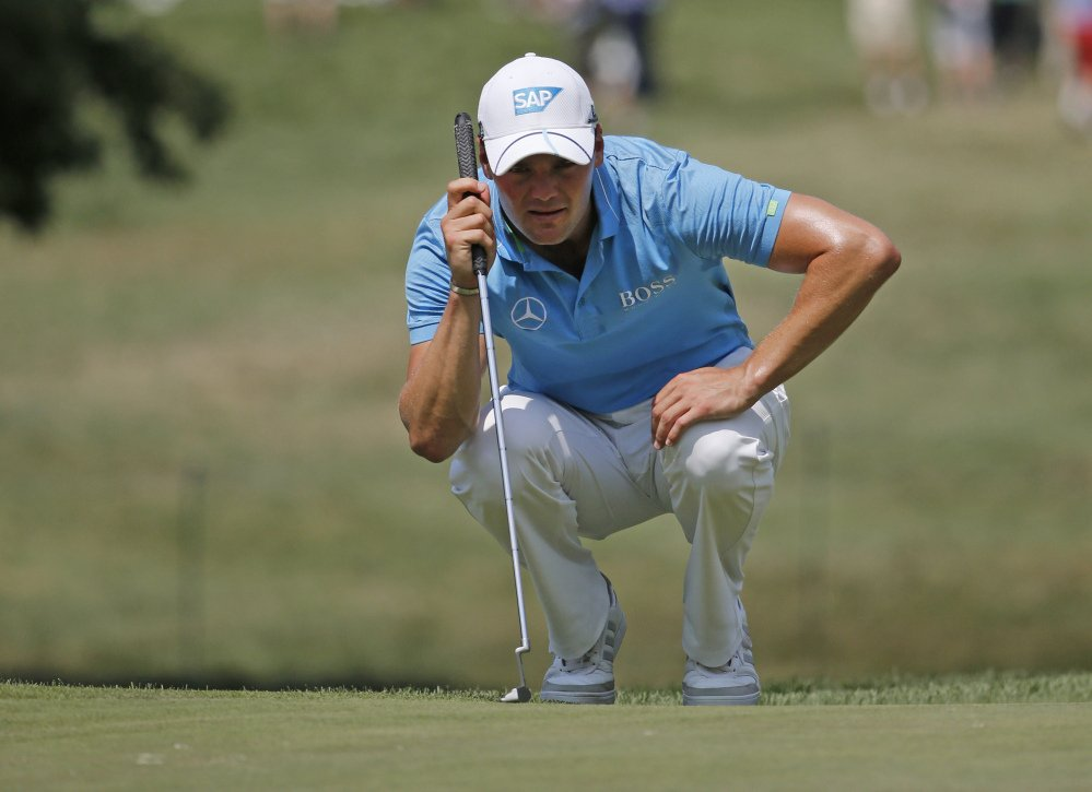 Martin Kaymer lines up a putt on the 15th hole during the first round of the PGA Championship golf tournament at Baltusrol Golf Club in Springfield, N.J., on Thursday.