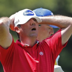 Scott Hend, of Australia, reacts to his tee shot on the 17th hole during the first round of the PGA Championship golf tournament at Baltusrol Golf Club in Springfield, N.J., on Thursday.