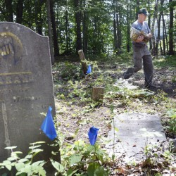 """Ken Mann of the Mann Cemetery Association works at the Freeport cemetery. The association wants improved access to the site. """"Just because you have a back door doesn't mean you don't want a front door,"""" Mann said."""