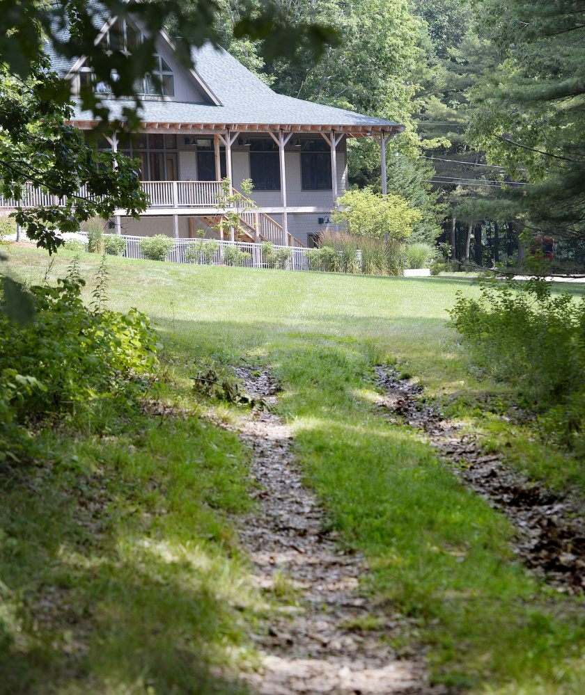 The gravel path that was used to access Mann Cemetery in Freeport was seeded and loamed by L.L. Bean for the Flying Point Paddling Center, effectively closing off access to the cemetery.
