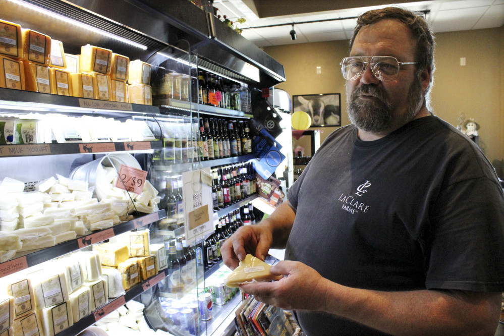 "Larry Hedrich holds cheese produced at LaClare Farms. ""We're competing in our farm here in Pipe, Wisconsin, with the world,"" he said. U.S. retail sales of goat cheese reached $142 million this year, up 8 percent from 2015."