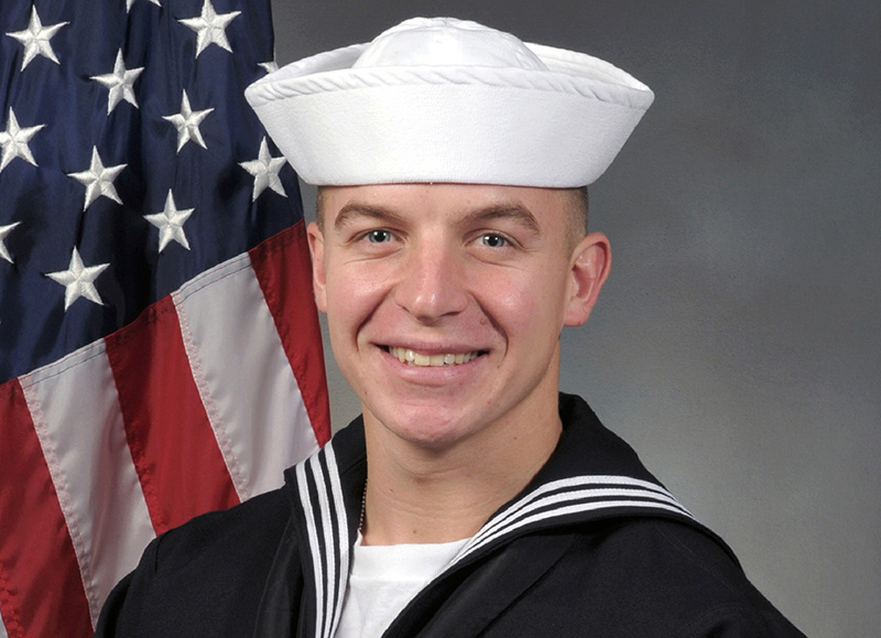 "A coroner's report says Seaman James ""Derek"" Lovelace died after struggling to tread water in fatigues, boots and a dive mask filled with water in a heated pool, which ranged in depth from 4-to-15 feet. He was seen on surveillance video being dunked at least twice by an instructor, the report notes."