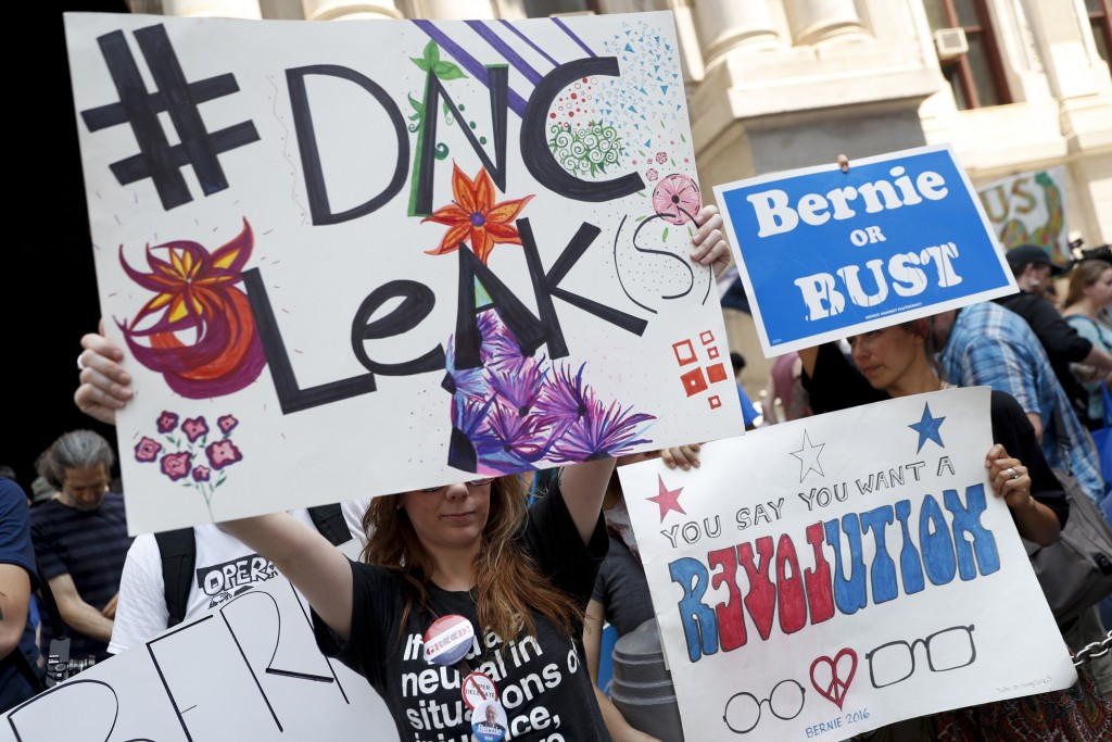 Demonstrators make their way around downtown Philadelphia during the first day of the Democratic National Convention on Monday. (Associated Press/John Minchillo)