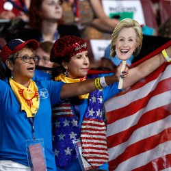 New Mexico delegates show their support for Hillary Clinton on the second day of the Democratic National Convention in Philadelphia on Tuesday.
