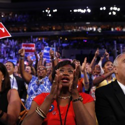 Delegates cheer as Democratic Presidential candidate Hillary Clinton appears on the screen during the second day session of the Democratic National Convention in Philadelphia, Tuesday, July 26, 2016. (AP Photo/Carolyn Kaster)