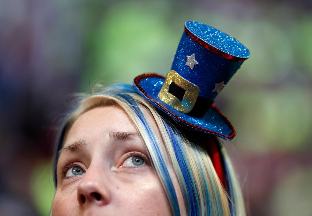 Pennsylvania delegate Anna Payne of Levittown wears a tiny hat on her appropriately colored hair during the final day of the Democratic National Convention in Philadelphia in Thursday.