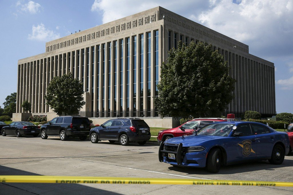 Police tape surrounds the Berrien County Courthouse on Monday in St. Joseph, Mich. Two bailiffs were fatally shot Monday inside the courthouse before officers killed the gunman, a sheriff said.