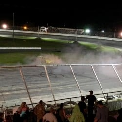 Dave St. Clair, 68, of Liberty, celebrates his win Saturday night at Wiscasset Speedway with a smoky burnout on the track's frontstretch.