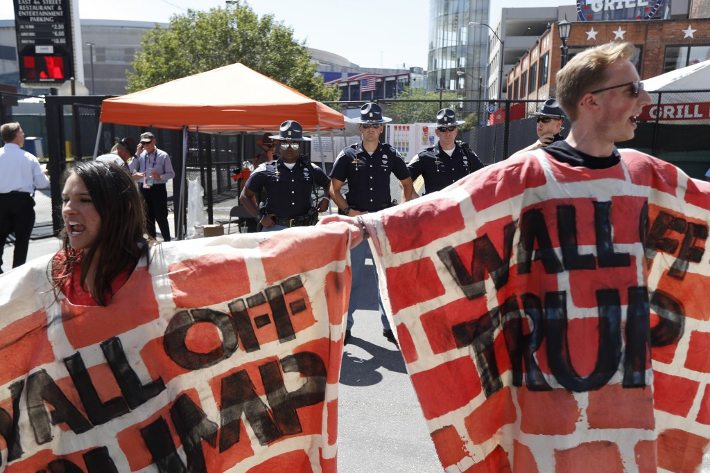Immigrant rights activists protest Republican presidential candidate Donald Trump's stated intention to build a wall at the Mexican border to keep out illegal immigrants. John Minchillo/Associated Press