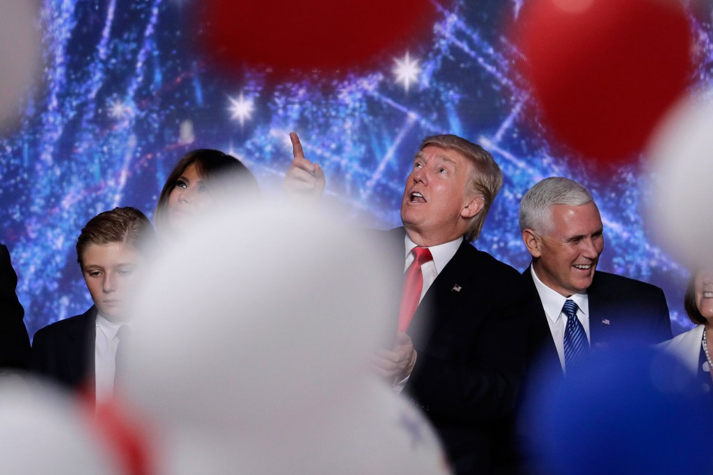 Donald Trump looks up at falling balloons as he stands on the stage with his son Barron, wife Melania and vice presidential nominee Mike Pence after his acceptance speech Thursday night. Associated Press/J. Scott Applewhite