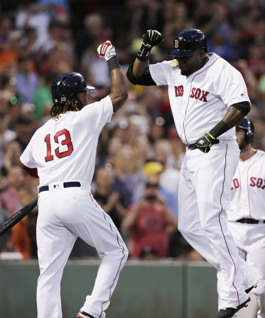 David Ortiz celebrates with Hanley Ramirez after Ortiz hit a three-run home run Tuesday night.    Associated Press/Charles Krupa