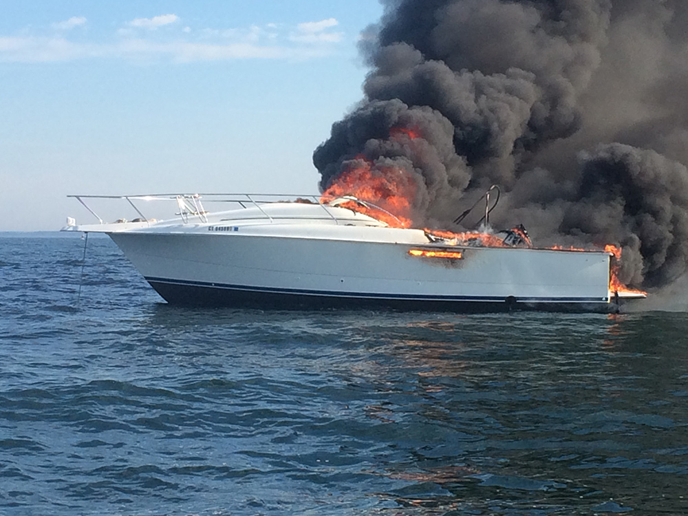 A 31-foot motor boat belonging to Timothy Lenz of Westport burns near Wood Island, off the coast of Saco, Tuesday. The boat eventually sank in about 100 feet of water. Maine Marine Patrol photo