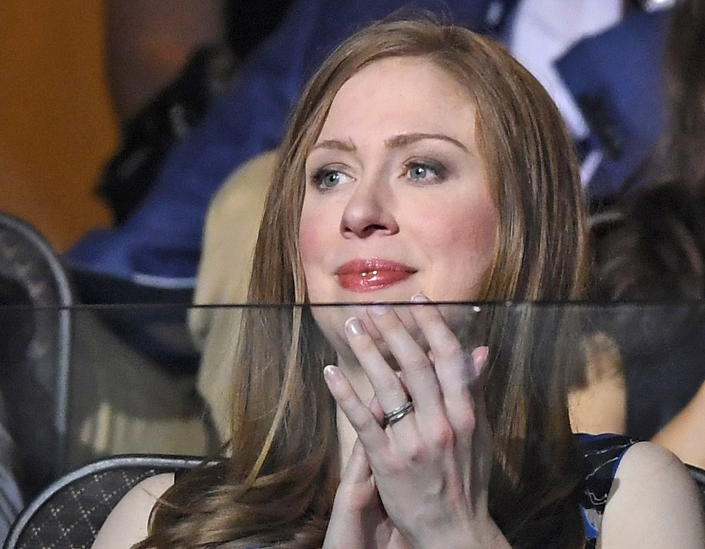 Chelsea Clinton watches the proceedings on Day 2 of the Democratic National Convention in Philadelphia Tuesday. She has spent most of her life in the public eye, moving to the White House at the age of 12 after her father was elected in 1992 and heading to Stanford University with a security detail in tow. Mark J. Terrill / Associated Press
