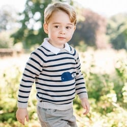 Recent but undated handout photo issued on Friday July 22, 2016 by William and Kate, the Duke and Duchess of Cambridge, of Britain's Prince George at Sandringham in Norfolk, England, who celebrates his third birthday on July 22. (Matt Porteous/Handout via AP)