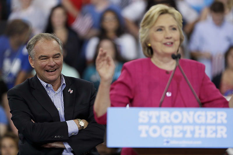 Democratic vice presidential candidate, Sen. Tim Kaine, D-Va. reacts as Democratic presidential candidate Hillary Clinton speaks during a campaign at Temple University on  Friday.