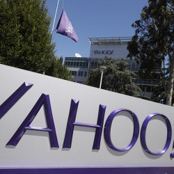 A Yahoo sign is seen at the company's headquarters Tuesday, July 19, 2016, in Sunnyvale, Calif. (AP Photo/Marcio Jose Sanchez)